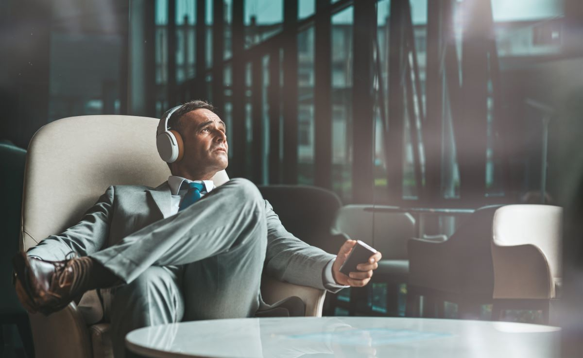 Businessman is Listening to Podcasts